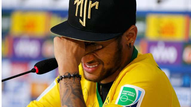 Neymar cries during a news conference