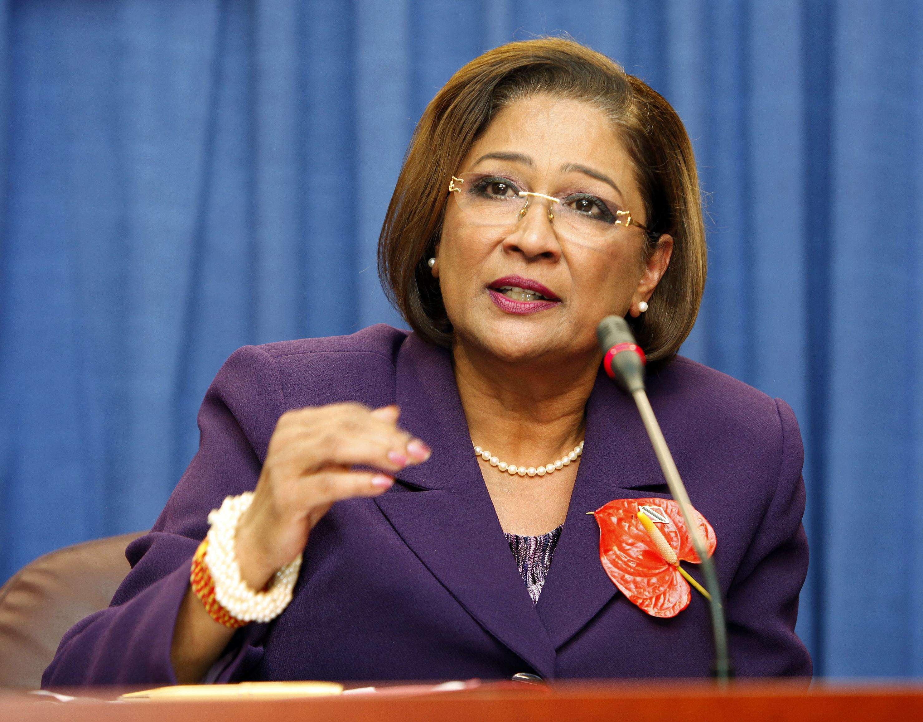 Trinidad and Tobago's Prime Minister Kamla Persad-Bissessar addresses a news conference in Port of Spain
