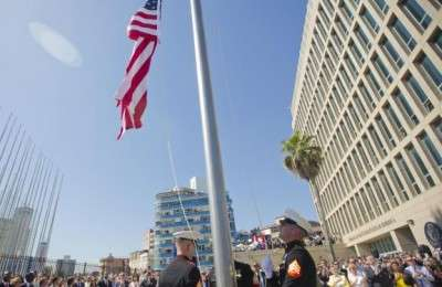 Members of the U.S. Marines raise the U.S. flag over the newly reopened embassy in Havana