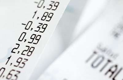 Close-up of shopping receipts with very shallow depth of field