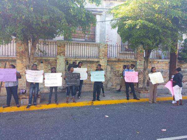 Group Protests Prison Deal Outside Parliament