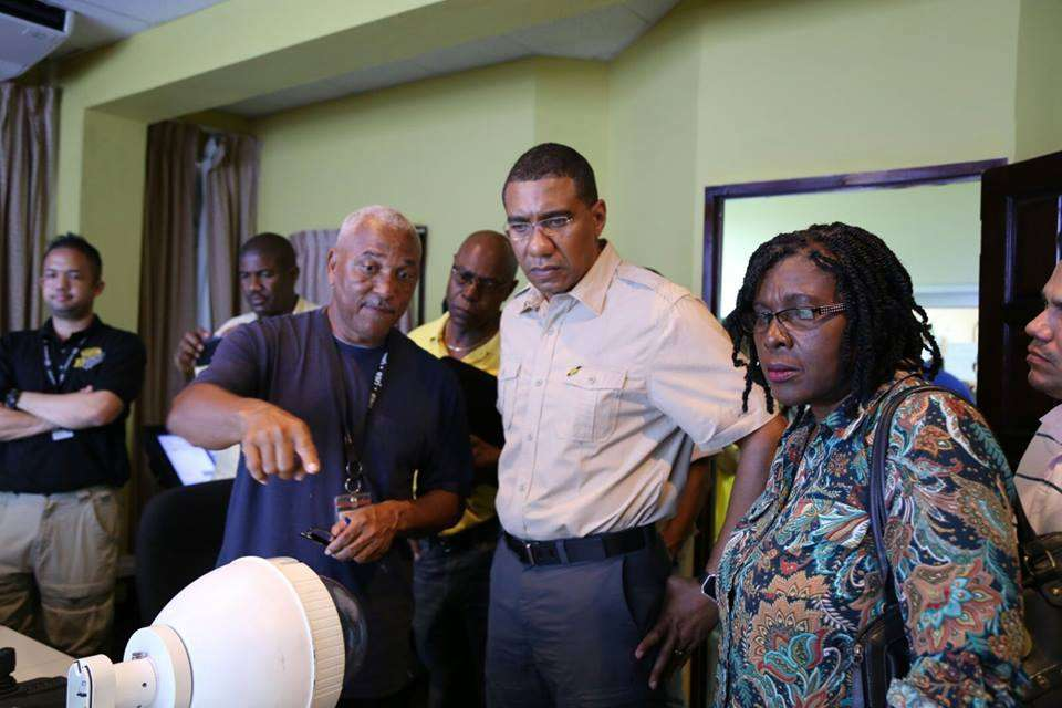 PM Holness Returns Home Early to Tour Rain-Damaged Parishes