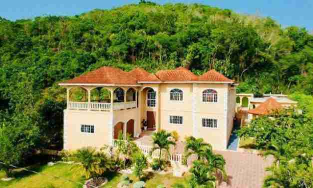 Police Raid Mansion of Suspected Cult Leader in Upscale St. James Community